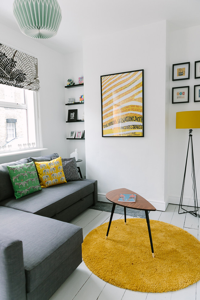 Inspiration for a scandinavian enclosed painted wood floor and white floor living room remodel in Dublin with white walls