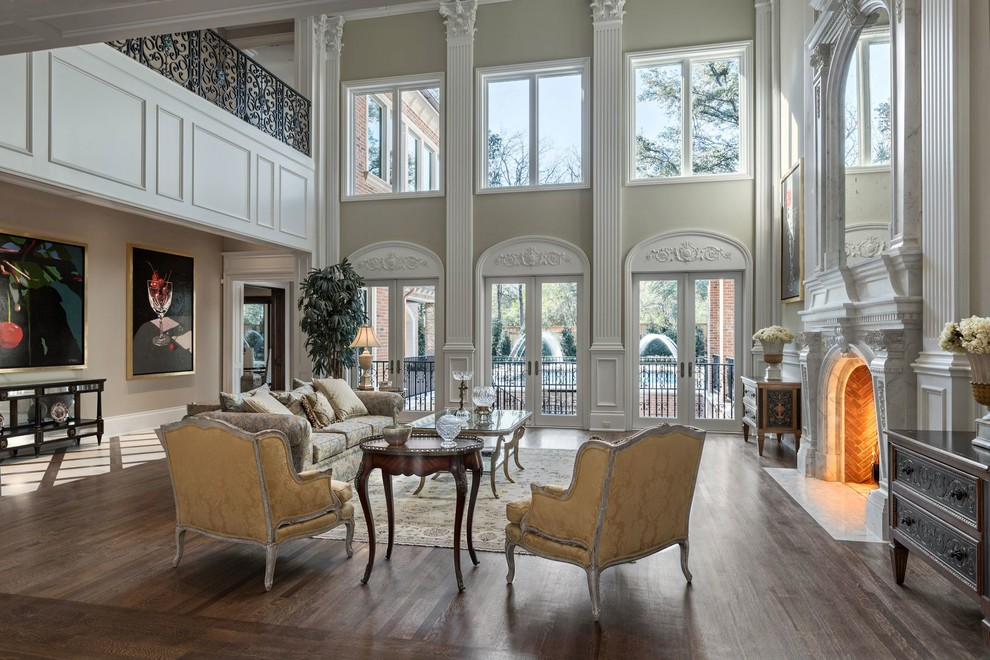 Example of a large ornate formal and enclosed dark wood floor living room design in Dallas with beige walls, a standard fireplace, no tv and a plaster fireplace
