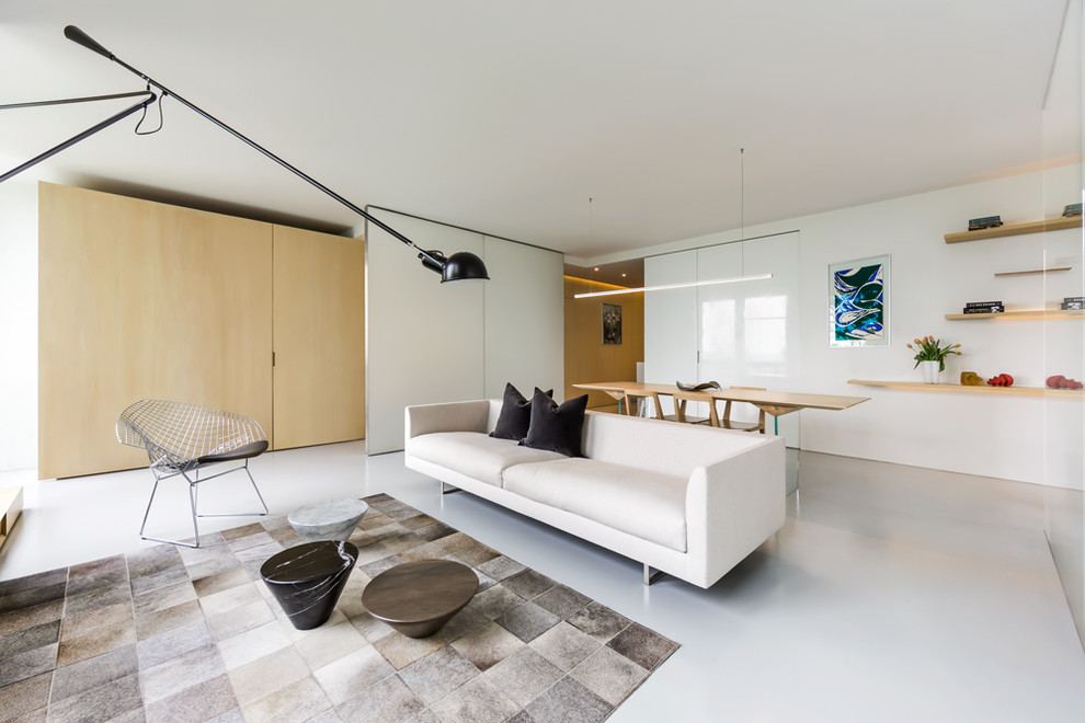 Example of a minimalist open concept white floor living room design in Chicago with white walls