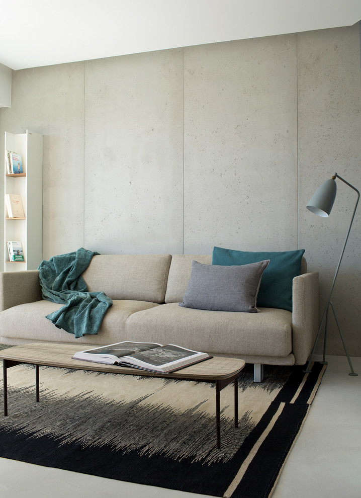 Inspiration for a mid-sized contemporary open concept concrete floor living room library remodel in London with gray walls, no fireplace and no tv