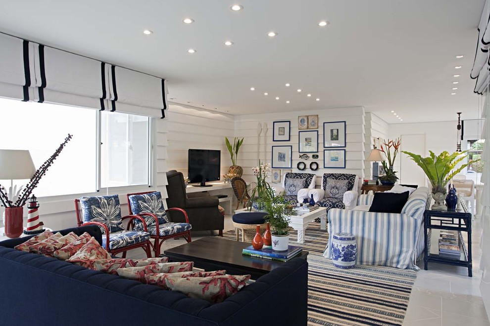 Inspiration for a contemporary living room remodel in Other with white walls and a tv stand