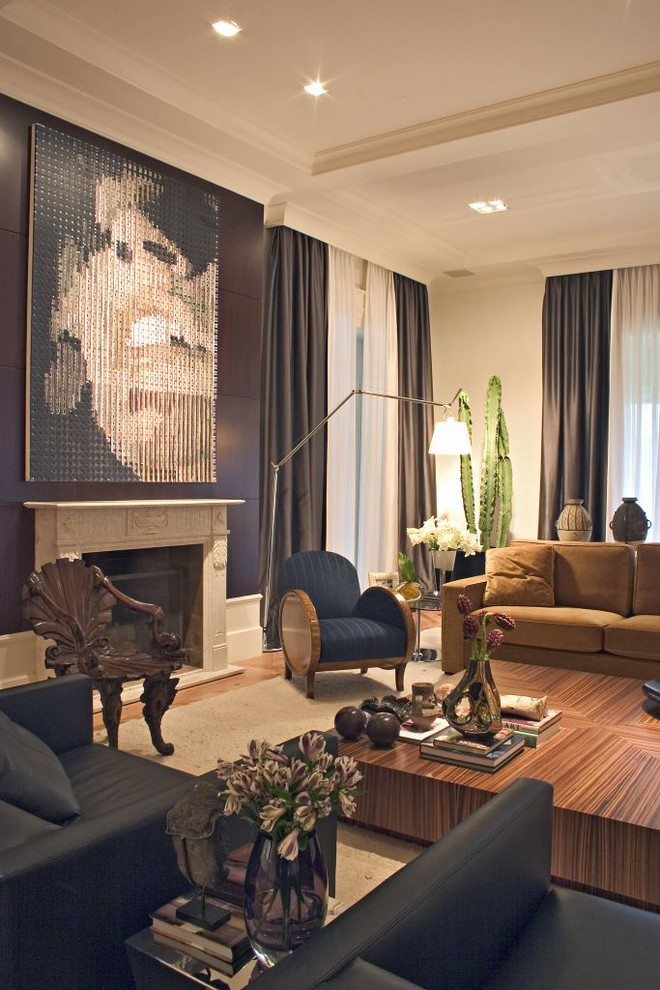 Inspiration for a contemporary living room remodel in Other with a standard fireplace