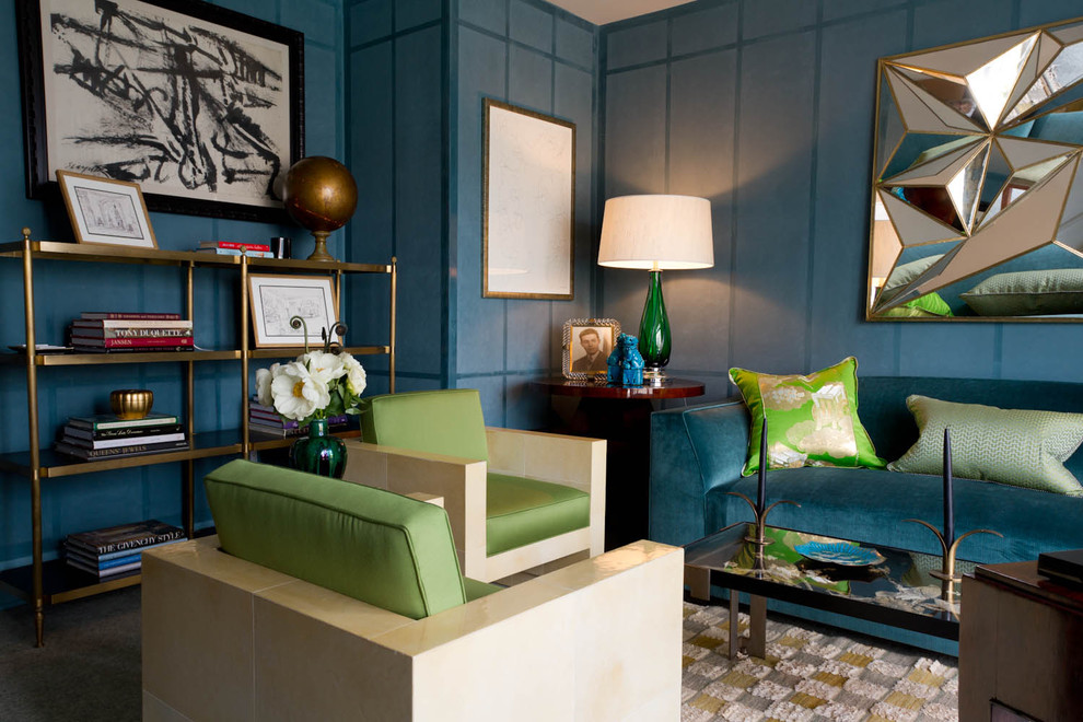 Example of a trendy living room library design in New York with blue walls