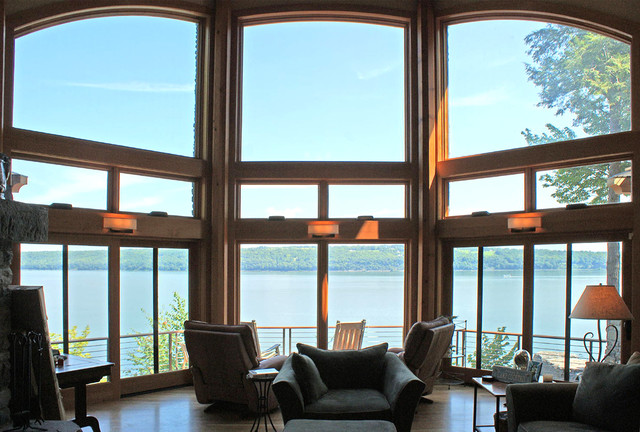 Stunning windows frame the view at shingle style lake home Lake house windows