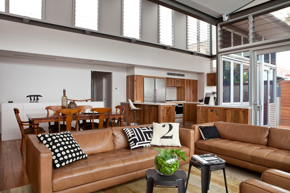 Example of a large transitional open concept medium tone wood floor living room design in Perth with white walls