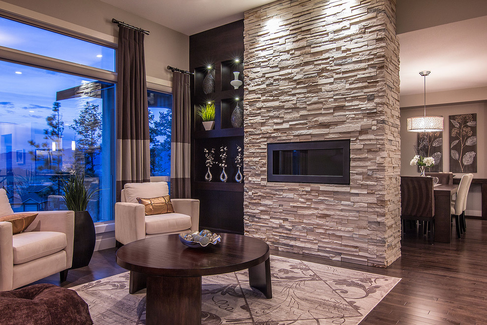 Example of a trendy formal dark wood floor living room design in Vancouver with a ribbon fireplace, beige walls, a stone fireplace and no tv