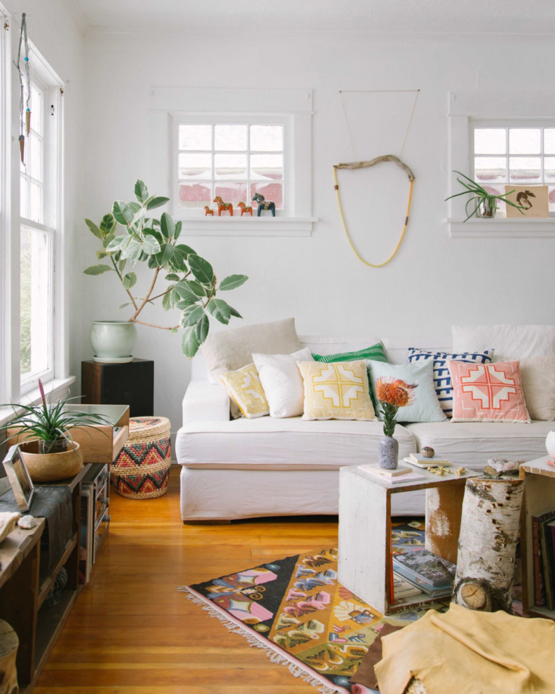 Inspiration for an eclectic medium tone wood floor living room remodel in Portland with white walls