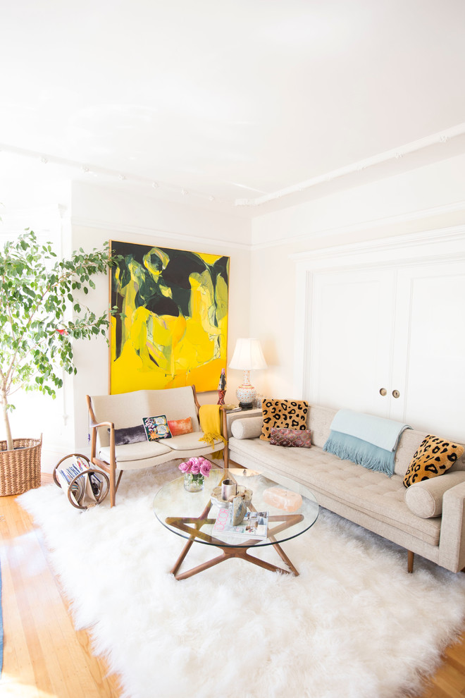 Inspiration for a small 1950s enclosed and formal light wood floor living room remodel in Los Angeles with beige walls
