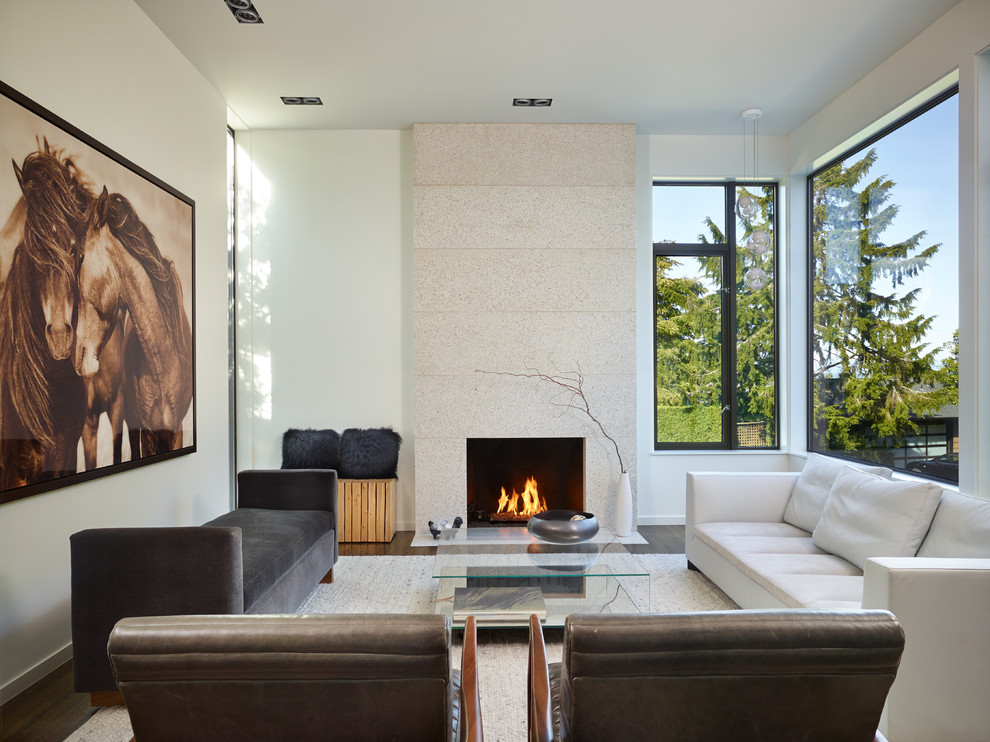 Example of a trendy living room design in Seattle with white walls and a standard fireplace