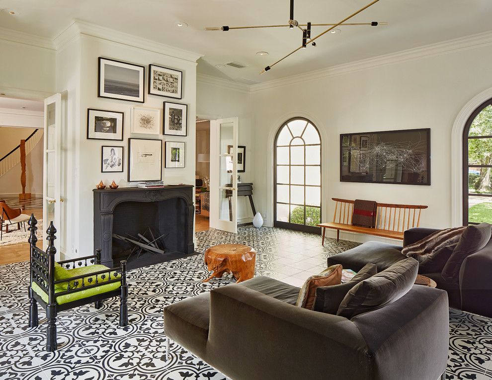 Example of a large eclectic enclosed and formal ceramic tile and multicolored floor living room design in Dallas with white walls, a two-sided fireplace, a concrete fireplace and no tv