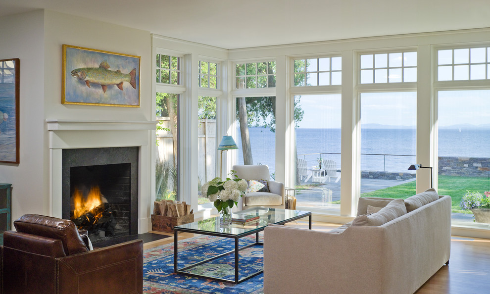 Example of a mid-sized classic open concept light wood floor living room design in Burlington with white walls, a standard fireplace, no tv and a stone fireplace