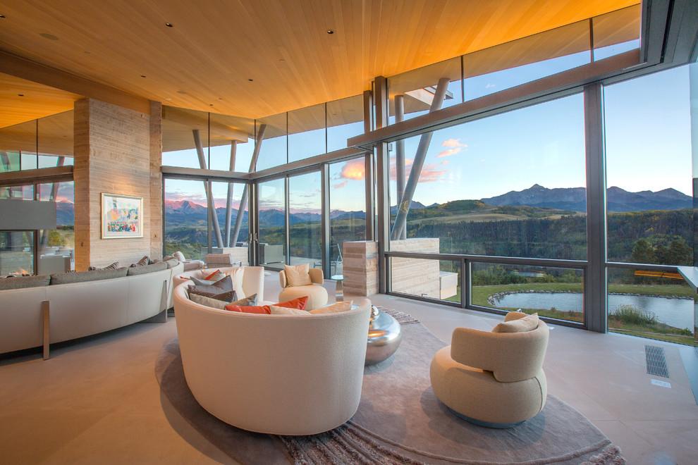 Trendy open concept beige floor living room photo in Denver