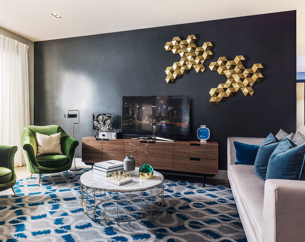 Living room - contemporary living room idea in Cedar Rapids with black walls and a tv stand