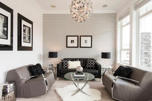 mur en papier peint à motifs graphiques placé derrière le canapé