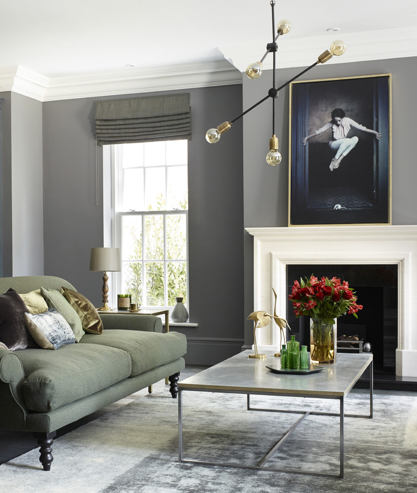 Living room - transitional living room idea in Surrey with gray walls and a standard fireplace