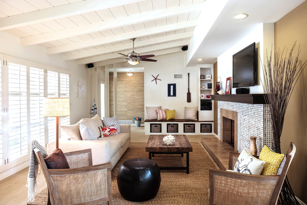 Example of a beach style formal light wood floor living room design in Miami with white walls, a standard fireplace, a tile fireplace and a wall-mounted tv