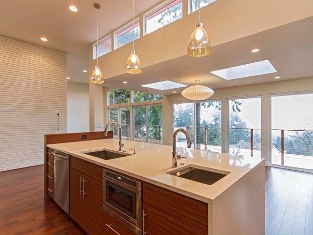 SW Portland Midcentury Modern Remodel by H. Hudson Homes midcentury-living-room