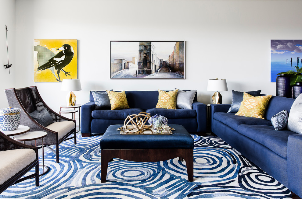 Example of a large trendy formal and open concept carpeted and blue floor living room design in Sydney with white walls, no fireplace and no tv