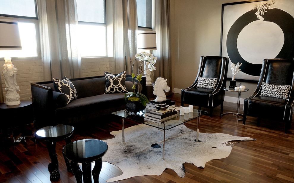 Living room - contemporary living room idea in Other with beige walls