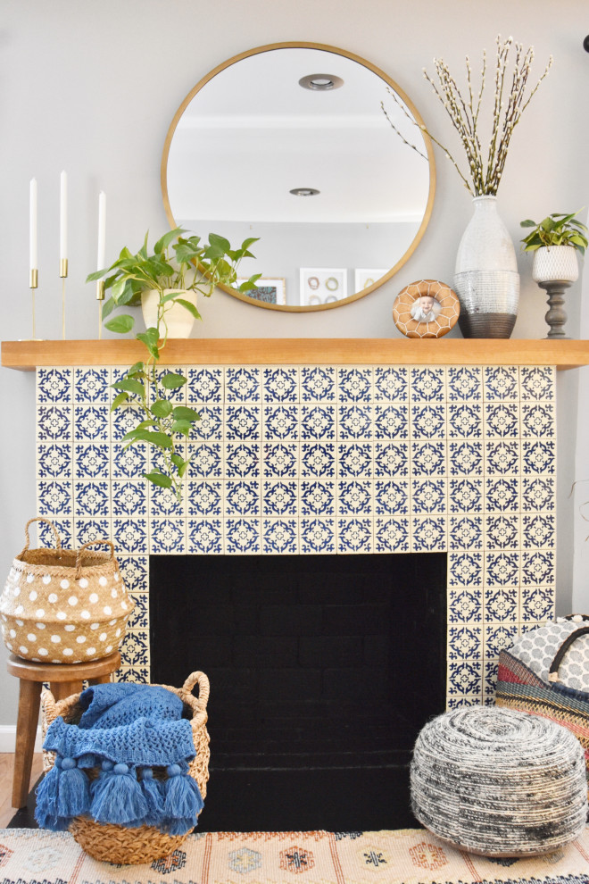 Small eclectic light wood floor living room photo in DC Metro with gray walls, a standard fireplace, a tile fireplace and no tv