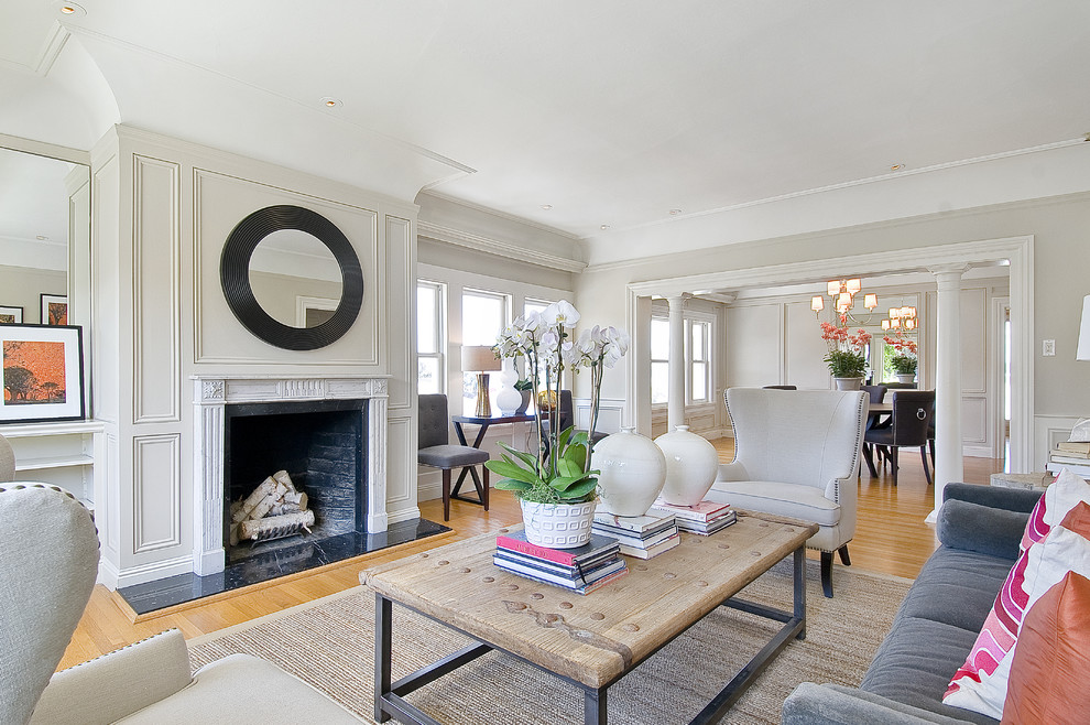 Example of a trendy living room design in San Francisco with beige walls and a standard fireplace