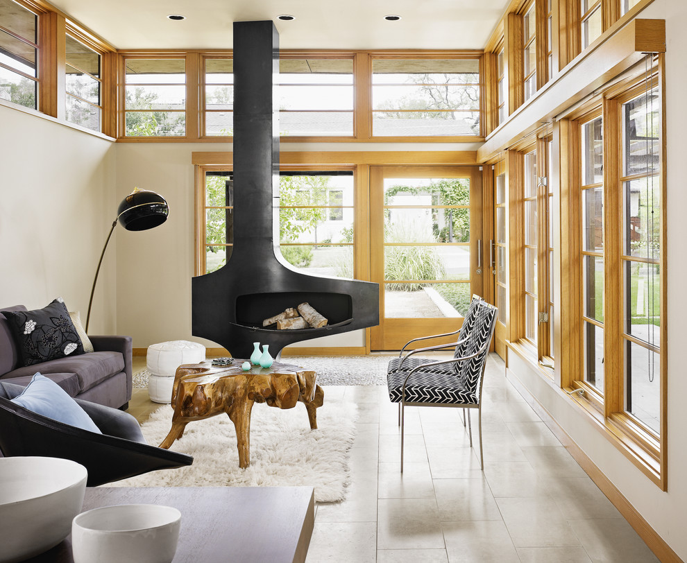 Living room - modern living room idea in Austin with beige walls and a standard fireplace