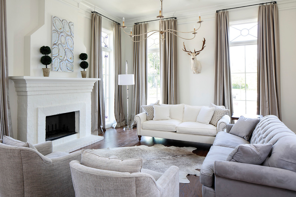 Example of a transitional dark wood floor living room design in Nashville with white walls, a standard fireplace and a brick fireplace
