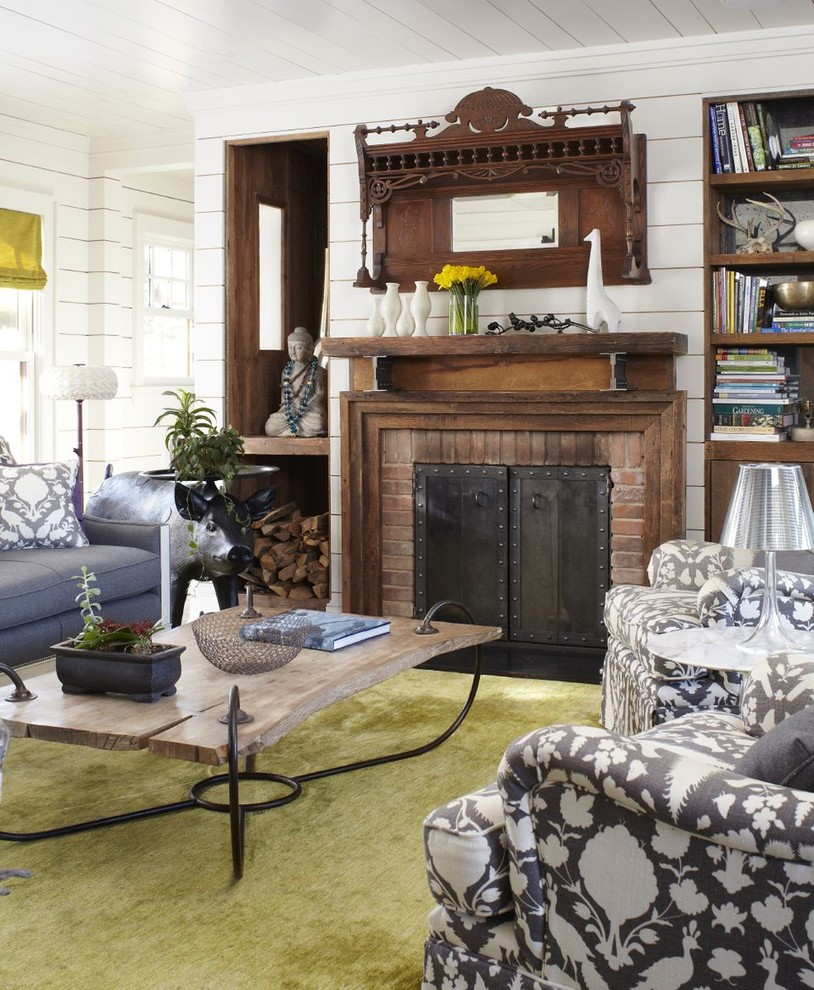Inspiration for a large farmhouse formal and enclosed carpeted living room remodel in New York with a brick fireplace, white walls, a standard fireplace and no tv