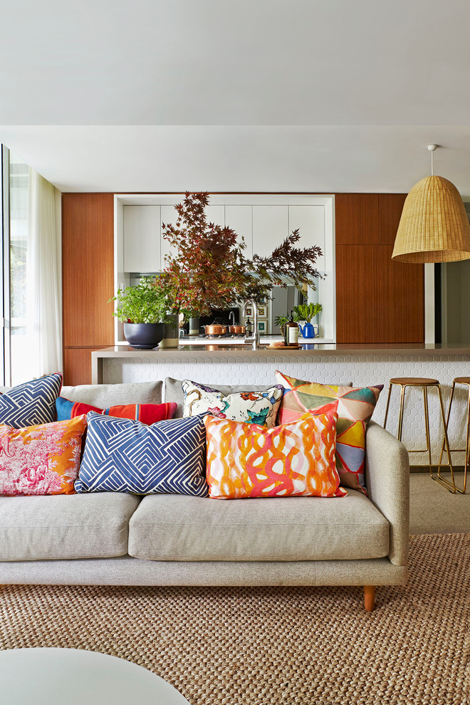 Inspiration for a mid-sized contemporary open concept carpeted living room remodel in Sydney with gray walls