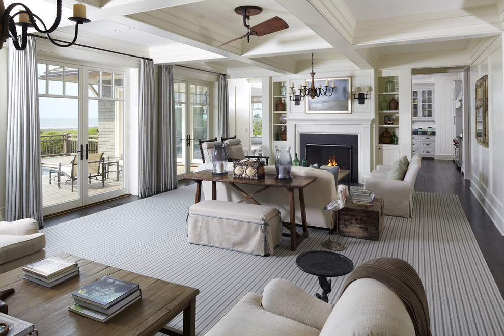 Living room - beach style living room idea in Charleston with white walls and a standard fireplace