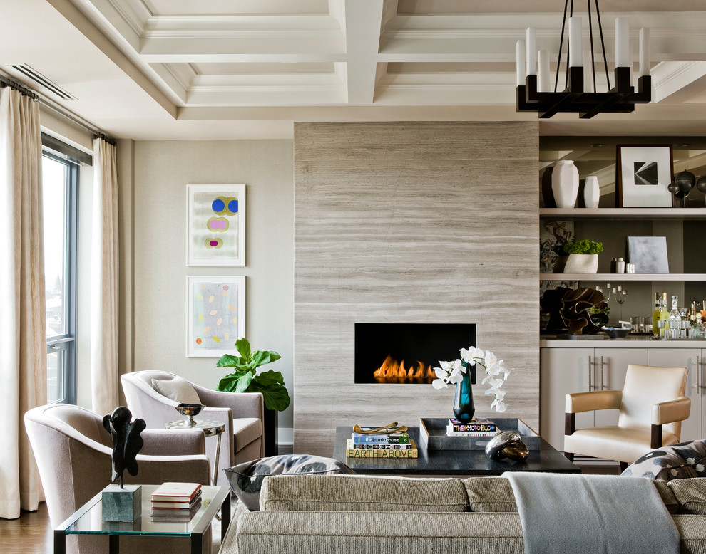 Example of a large transitional formal and open concept medium tone wood floor, brown floor and tray ceiling living room design in Boston with beige walls, a ribbon fireplace, a stone fireplace and no tv