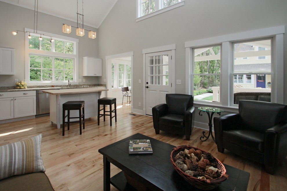 Example of an arts and crafts open concept light wood floor living room design in Indianapolis with gray walls