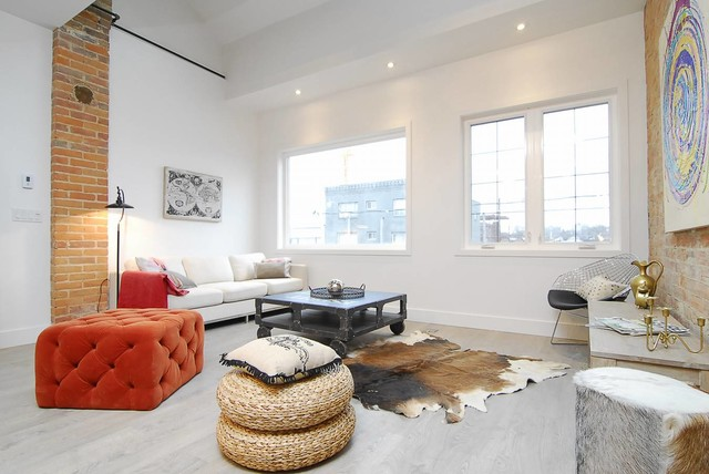 Example of a danish formal painted wood floor living room design in Toronto with white walls
