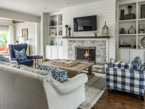 modern country living room with a central fire place
