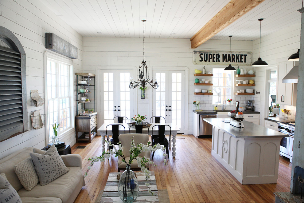 Example of a mid-sized cottage chic open concept medium tone wood floor living room design in Austin with white walls and no tv