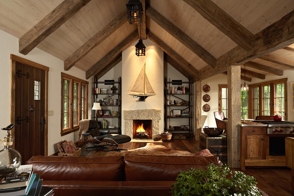 Inspiration for a rustic dark wood floor living room remodel in Minneapolis with a standard fireplace