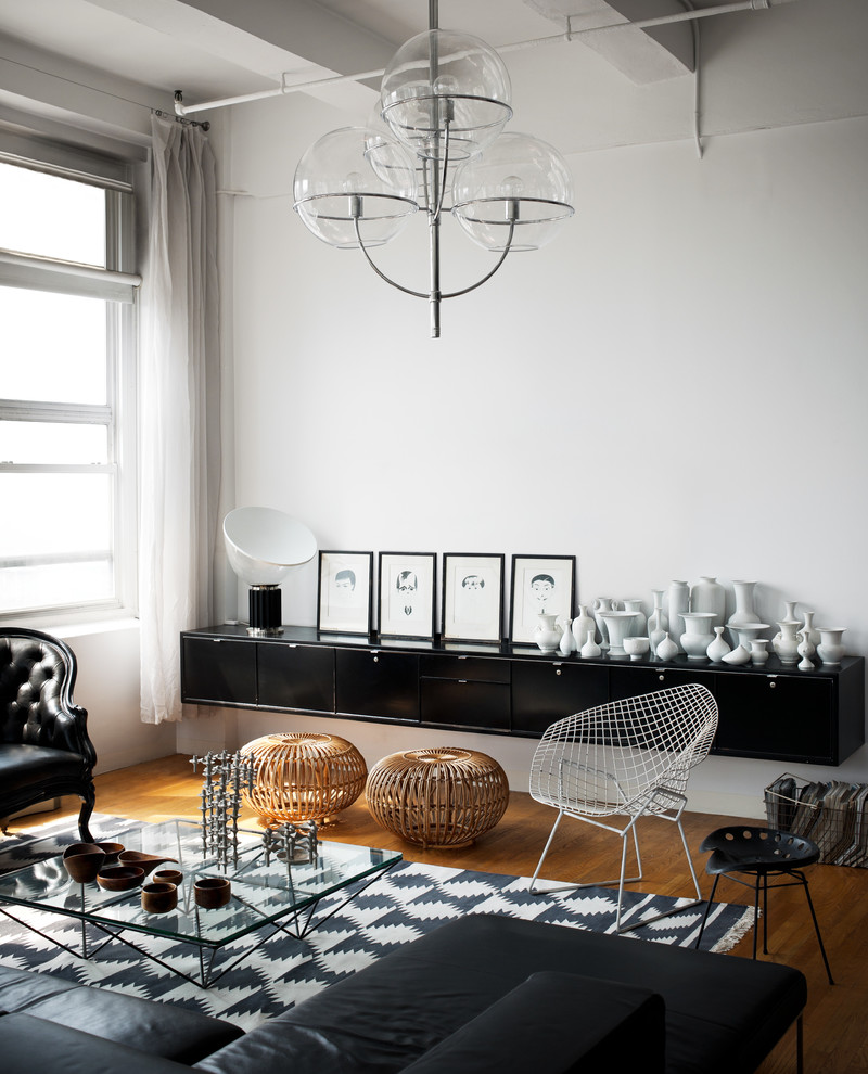 Example of an urban painted wood floor living room design in New York with white walls