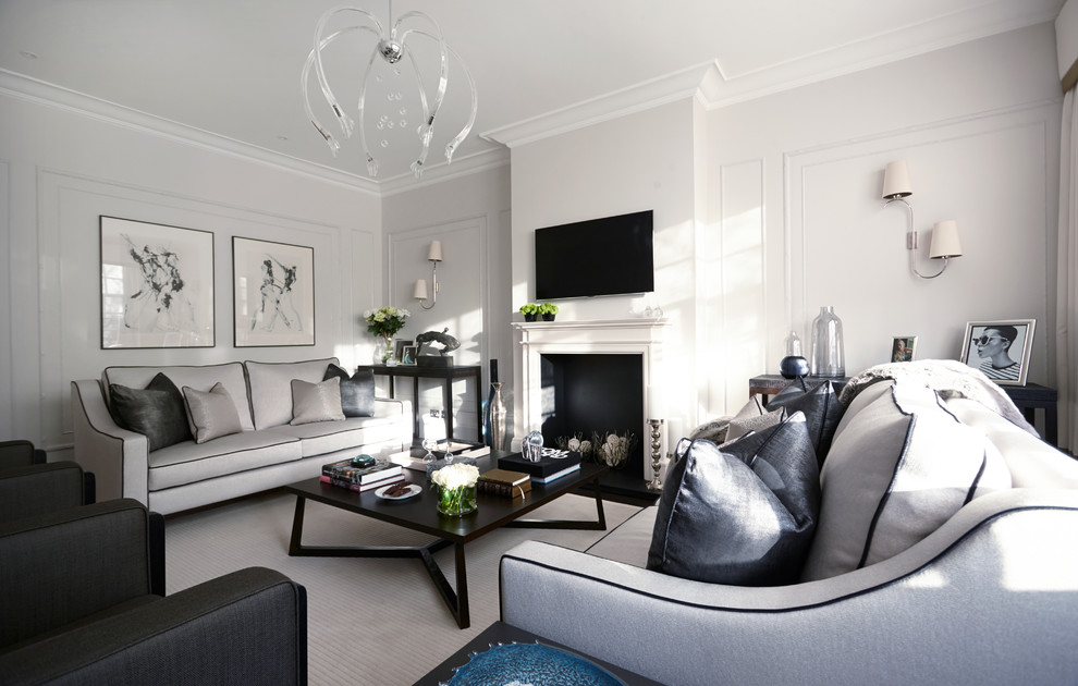 Example of a trendy formal living room design in London with white walls and a wall-mounted tv