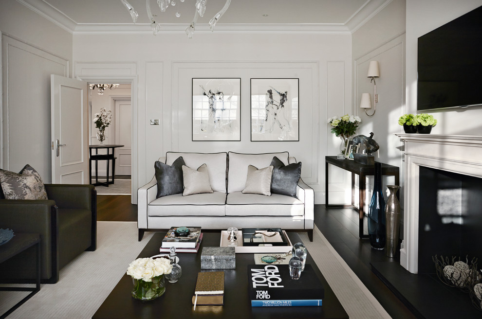 Trendy formal dark wood floor living room photo in London with white walls and a wall-mounted tv