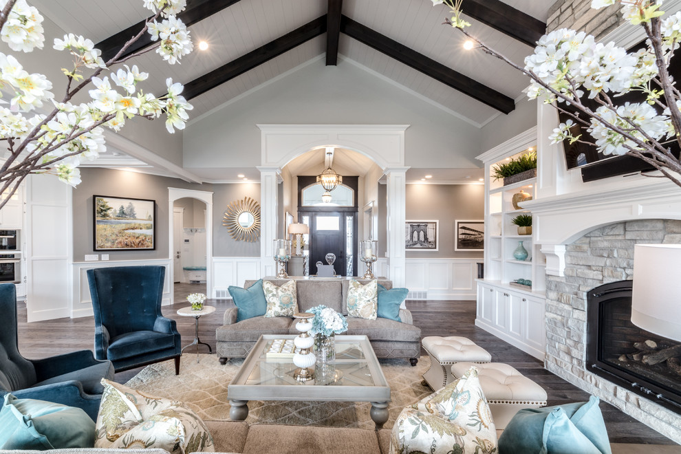 Living room - large traditional open concept and formal dark wood floor and gray floor living room idea in Salt Lake City with gray walls, a standard fireplace, a stone fireplace and a wall-mounted tv