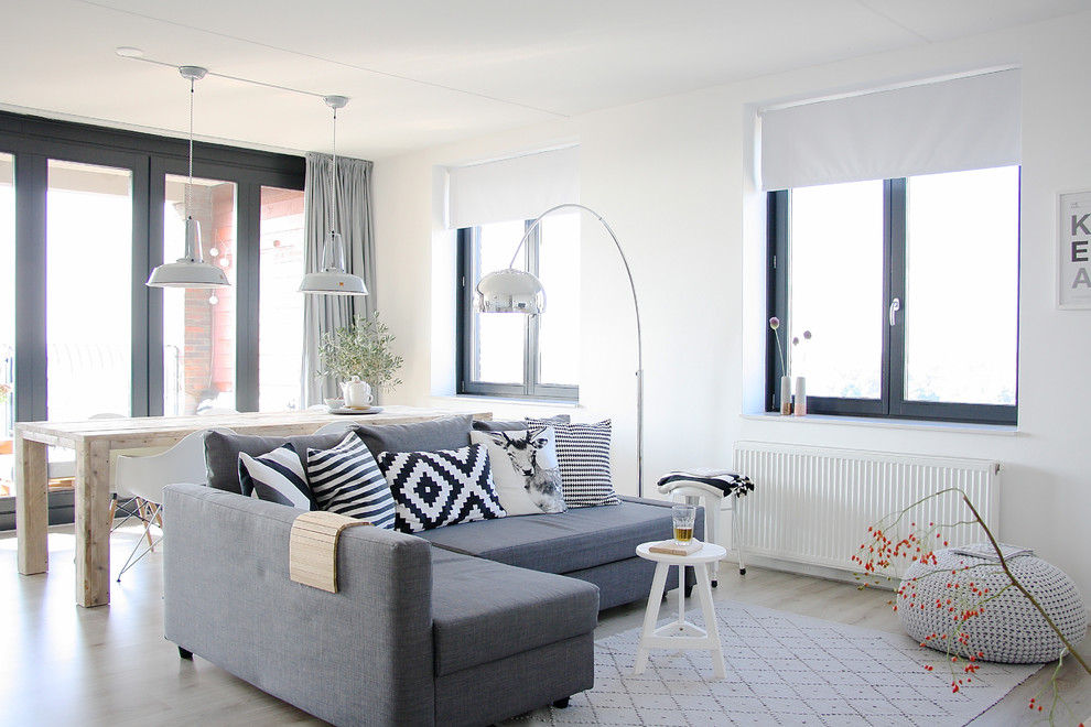 Example of a small danish open concept living room design in Amsterdam
