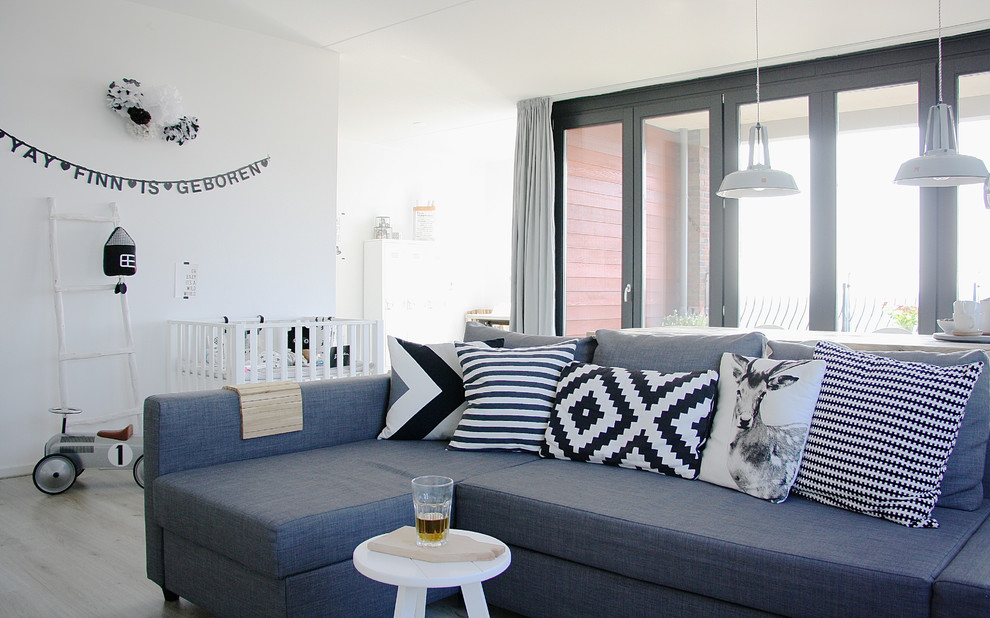 Danish living room photo in Amsterdam with white walls
