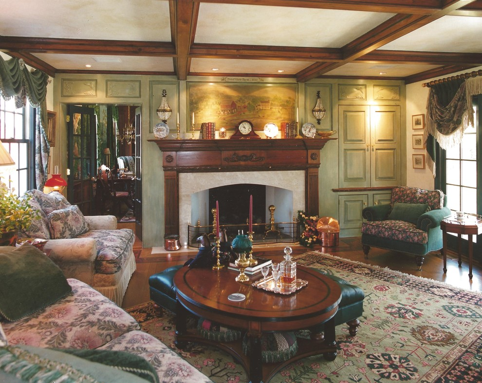 Example of a mid-sized classic enclosed medium tone wood floor living room design in Philadelphia with a standard fireplace, a wood fireplace surround and a concealed tv