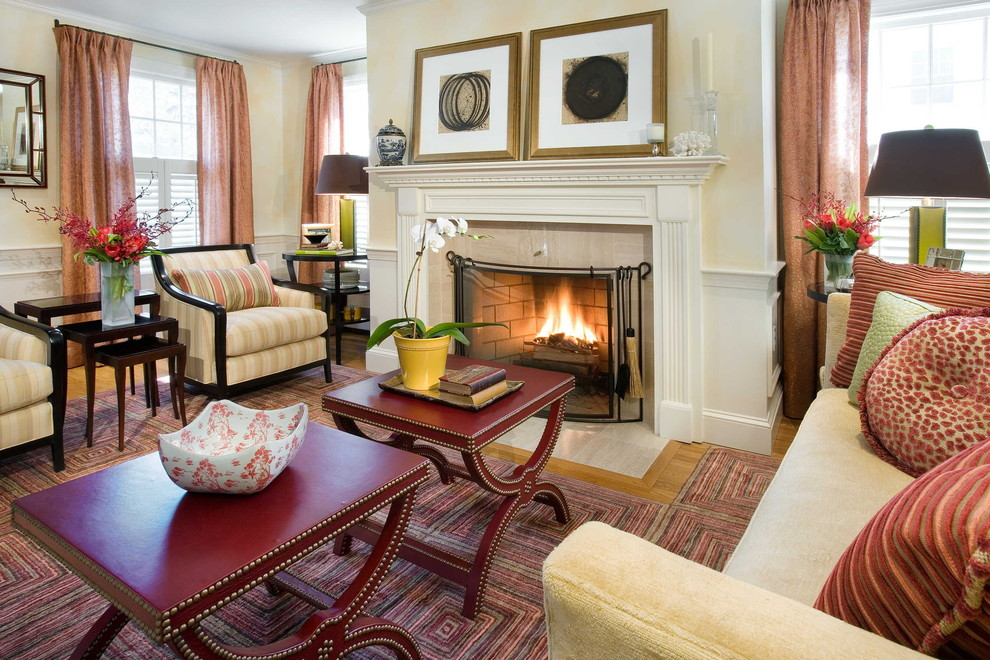 Elegant living room photo in Boston with beige walls and a standard fireplace