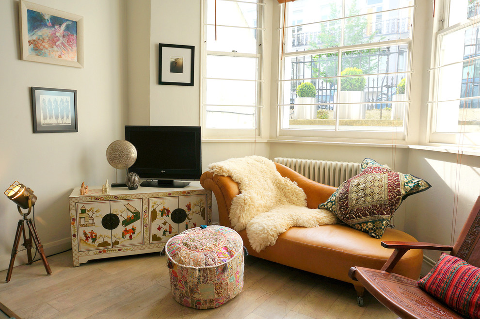 Living room - eclectic light wood floor living room idea in London with white walls and a tv stand