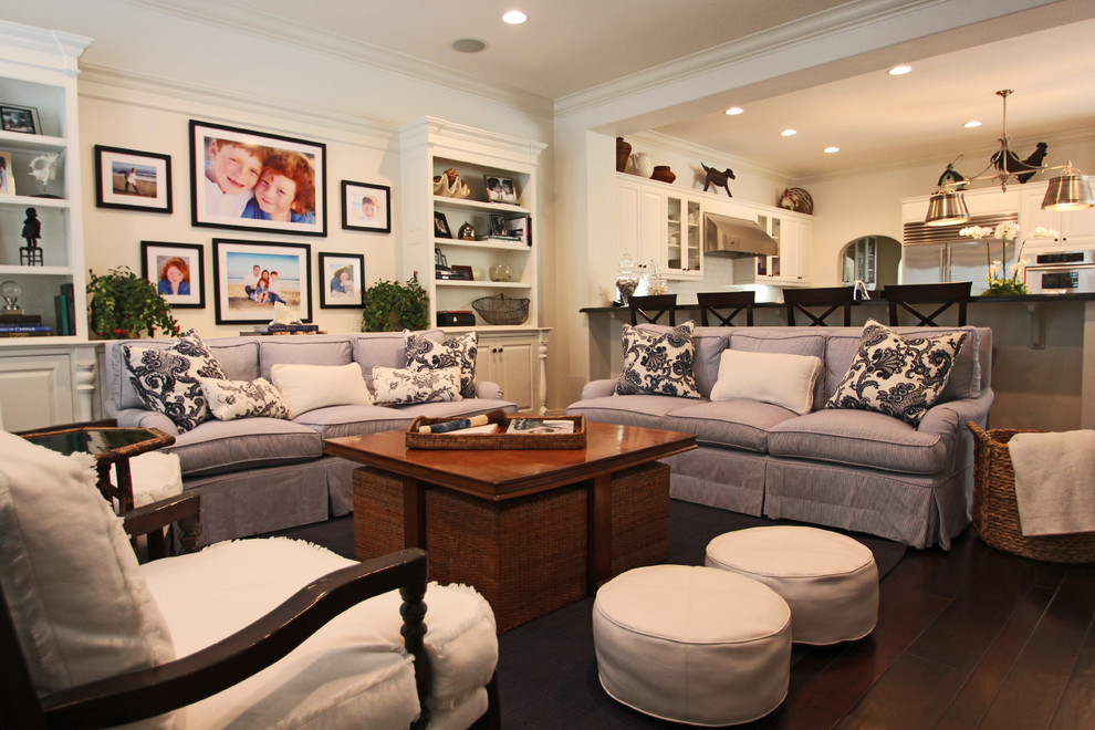 Example of a trendy open concept living room design in Los Angeles with white walls