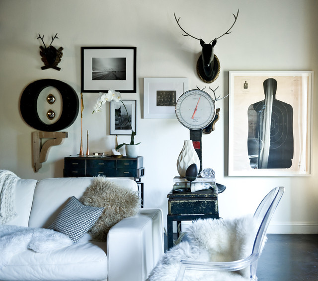 Inspiration for an eclectic living room in Dallas with white walls.