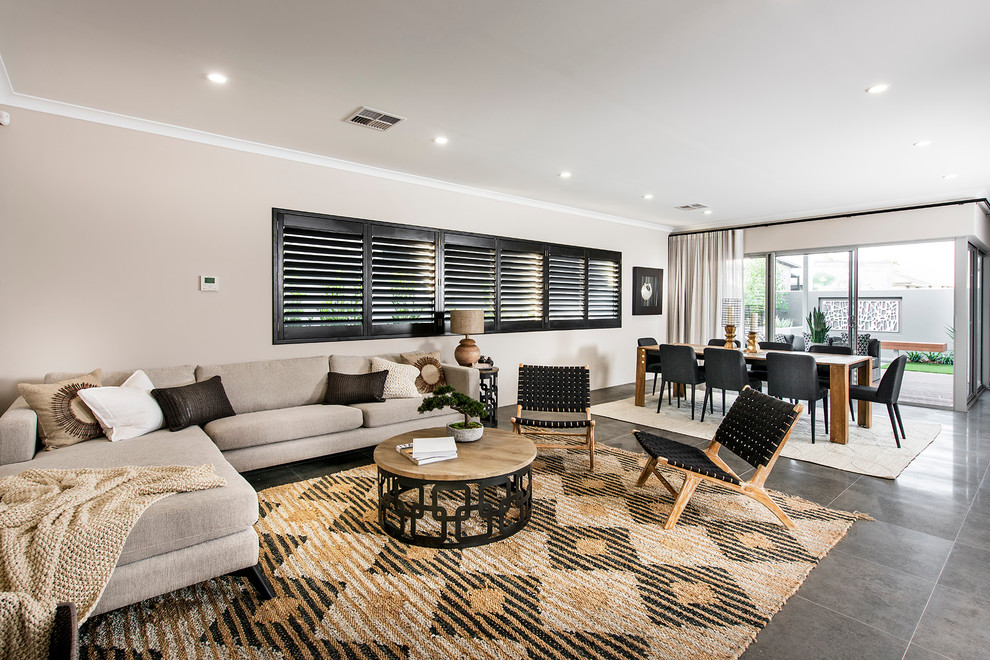 Inspiration for a contemporary open concept and formal ceramic tile living room remodel in Perth with beige walls