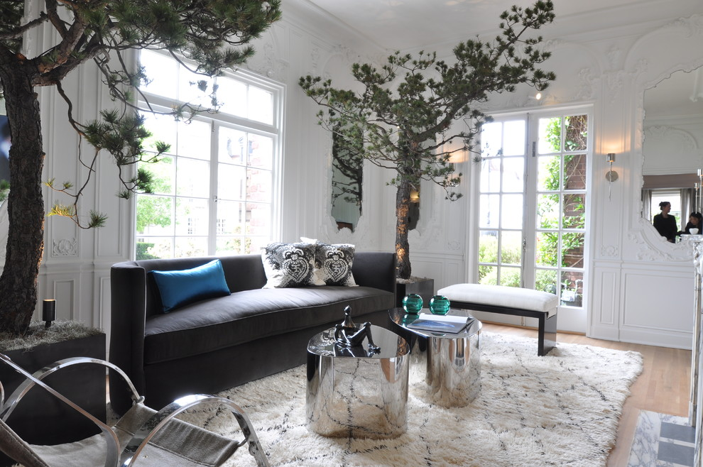 Trendy living room photo in San Francisco with white walls and a standard fireplace