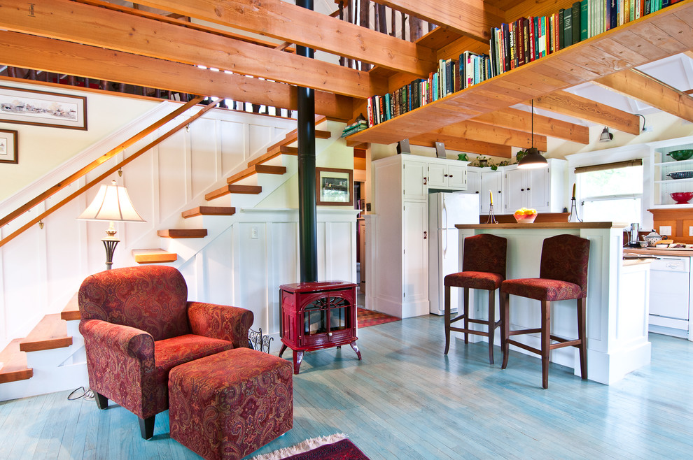 Small eclectic open concept blue floor living room library photo in Melbourne with a wood stove